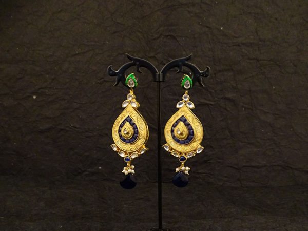 long super stylish leaf kundan earrings