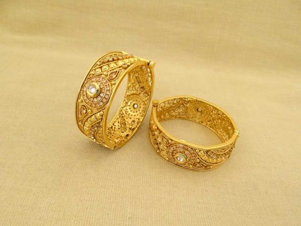 broad round designed celebrity antique bangles